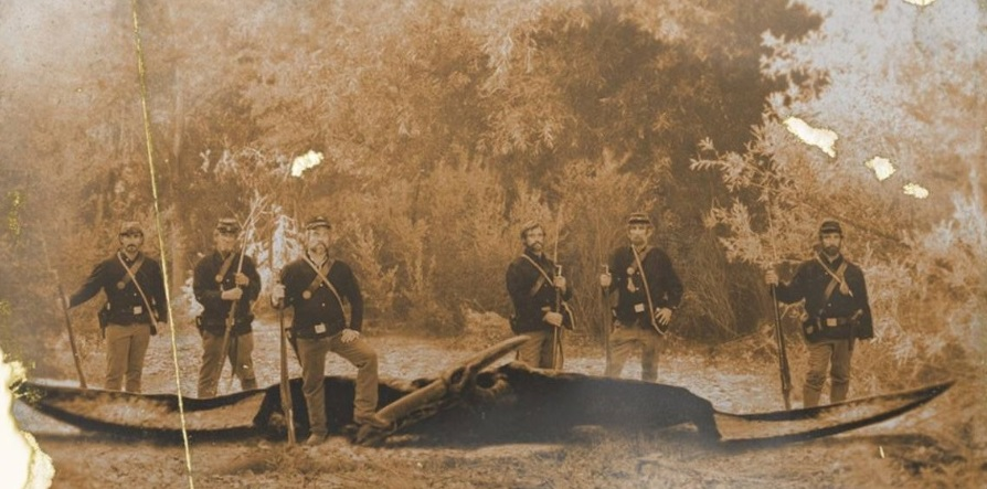 controversial photograph of what looks like six Union soldiers standing over the remains of a large Pteranodon